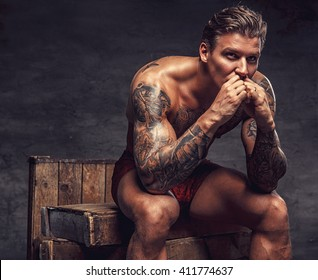 Naked guys with ink