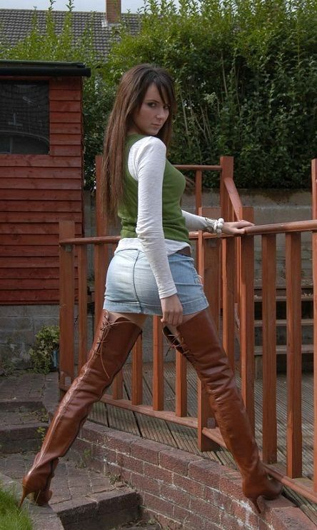 Sexy woman kissing in booots