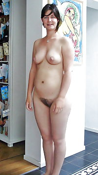 Standing naked mature woman