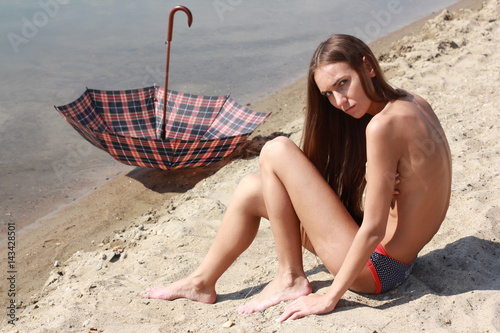 Young naked beach